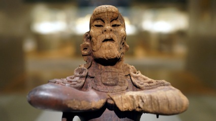 Mirror-Bearer, 6th century (Classic Maya), wood and red hematite, 35.9 x 22.9 x 22.9 cm (The Metropolitan Museum of Art)